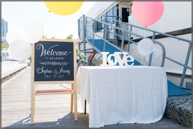 Welcome your wedding guest from the dockside table up the gangway.