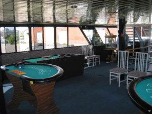 Casino tables set up including black jack and poker.
