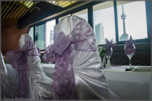 Chair covers with lavender bows.