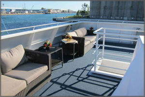 Rental sofas for corporate cruise set up on outside deck.