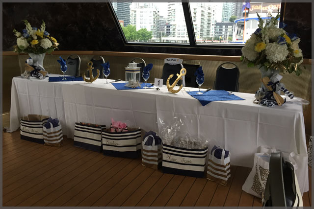 Head table for nautical theme cruise with decor.
