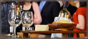 Wine glasses, cheese and crackers on a public cruise.