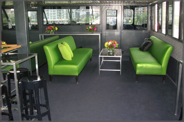 Corporate cruise with rental sofas in bright green vinyl.