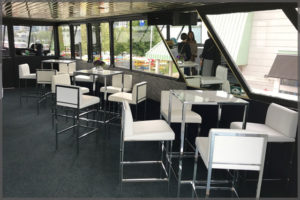 Rented cruiser tables with white vinyl chairs and chrome bases.