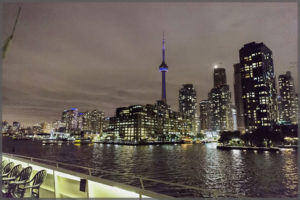 Toronto skyline and the CN Tower while cruising the harbour at night.