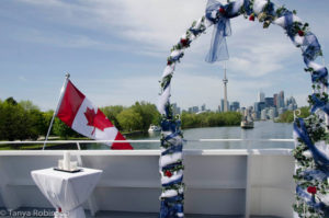 View of the Toronto skyline through a wedding arch on the deck of the cruise ship Yankee Lady IV.