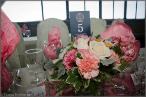 Wedding centrepiece with pink and white flowers.