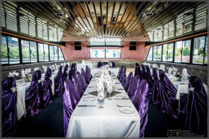Wedding decor with mauve chair covers.