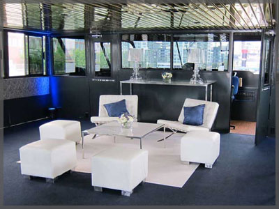 Custom white furniture for corporate event aboard a Toronto boat cruise.