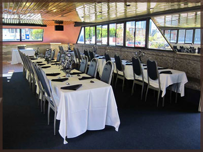 Main dining salon of the Yankee Lady III set up for Toronto boat cruises.