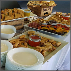 Variety of appetizers like fried samosas, spring rolls and roasted vegetables.