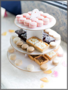 Three tiers of cookies and tarts.