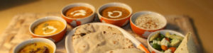 Indian Naan with various bowls of dipping spices.