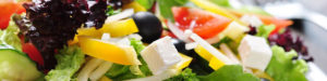 Leaf lettuce, yellow peppers, black olives, tomatoes and feta cheese mixed salad.