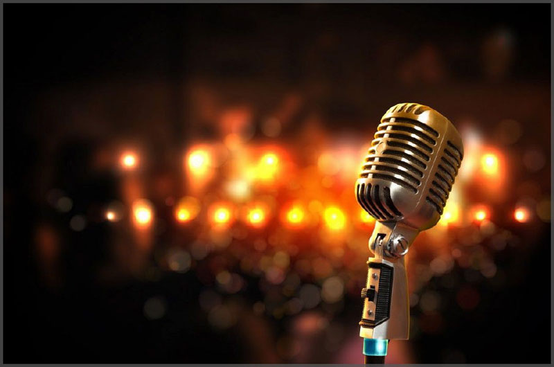 Old style Karaoke microphone with stage lights waiting for the next star.